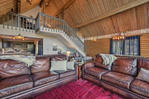 A seating area at Pristine Flagstaff Cabin with Decks and Mountain Views!