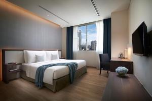 A bed or beds in a room at Shama Sukhumvit Bangkok