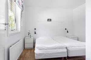 Säng eller sängar i ett rum på First Camp Torekov-Båstad