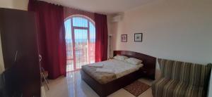 Кровать или кровати в номере Inn Pallada