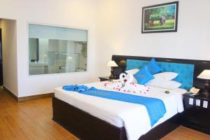 Ein Bett oder Betten in einem Zimmer der Unterkunft River Beach Resort & Residences