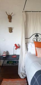 A bed or beds in a room at Convento Senhora da Vitória