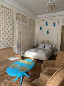 Łóżko lub łóżka w pokoju w obiekcie Golden Boutique Apartments