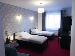 Łóżko lub łóżka w pokoju w obiekcie Pensjonat Wrzos