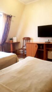 A bed or beds in a room at Kroshka Enot Mitino