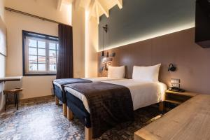 A bed or beds in a room at ibis Styles Chaves