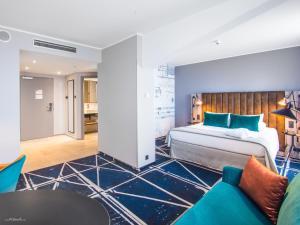 Łóżko lub łóżka w pokoju w obiekcie Hotel Mercure Poznań Centrum
