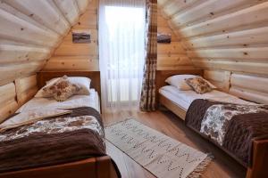 Postel nebo postele na pokoji v ubytování Leśny Dwór Premium Chalets Zakopane