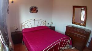 A bed or beds in a room at Villa Cala Creta