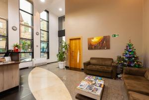 The lobby or reception area at Tri Hotel & Flat Caxias
