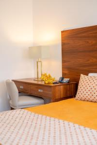 Uma cama ou camas num quarto em Hotel Nossa Senhora da Paz