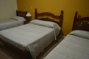 Cama o camas de una habitación en Hotel Obino São Borja