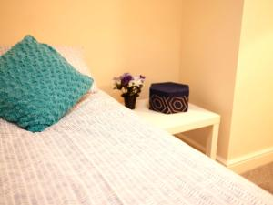 A bed or beds in a room at City Centre Apartment 361a