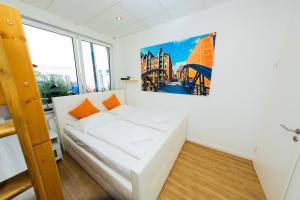 Ein Bett oder Betten in einem Zimmer der Unterkunft City Apartment Reeperbahn Hamburg