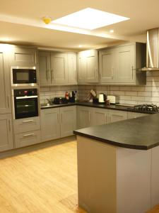 A kitchen or kitchenette at City Centre Apartment 361a