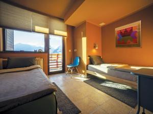 Кровать или кровати в номере Tsar Bani Spa Resort