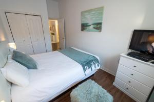 Un ou plusieurs lits dans un hébergement de l'établissement Les Appartements centre-ville Québec