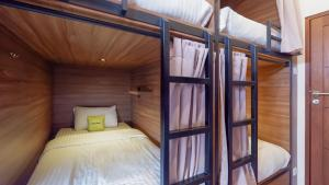 A bed or beds in a room at Fello B&B Hostel