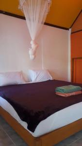 A bed or beds in a room at Funky Fish Garden Resort
