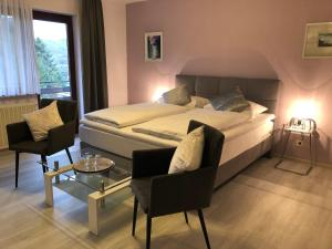 A bed or beds in a room at Pension Dabrunz