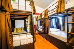 A bunk bed or bunk beds in a room at U.R.D.Ki Hostel