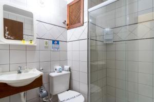 Um banheiro em Hotel Ponta das Toninhas