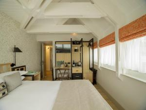 A bed or beds in a room at Minster Mill Hotel & Spa