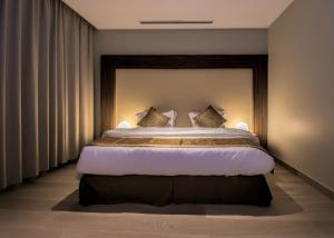 Cama ou camas em um quarto em Tiara
