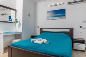 Кровать или кровати в номере Guest House Sidro