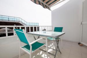 A balcony or terrace at Apartamentos Juan Benítez