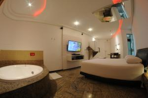 A bathroom at Nexos Motel Tamarineira (Adult Only)