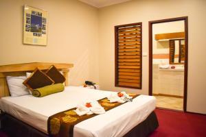 Cama o camas de una habitación en Grand Eastern Hotel