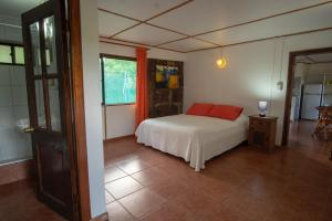 A bed or beds in a room at Hare Aukara
