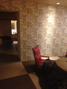 A bed or beds in a room at Ten Ten Temari