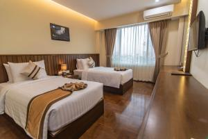 A bed or beds in a room at Hotel New Wave