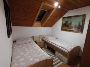 Postelja oz. postelje v sobi nastanitve Apartment Krek