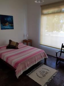 Una cama o camas en una habitación de GLAMAUÉ