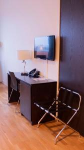 A television and/or entertainment center at Hotel Montebello