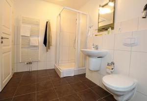 Ein Badezimmer in der Unterkunft Aparthotel Markt Fuffzehn