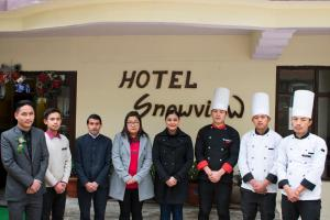 Members of staff at Hotel Snow View on Cloud Nine