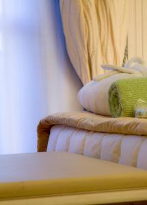 A bed or beds in a room at Grand Hotel Terme