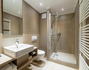 Ein Badezimmer in der Unterkunft Thomas Hotel Spa & Lifestyle