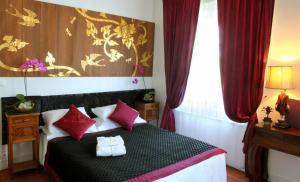 A bed or beds in a room at Castel De Siam