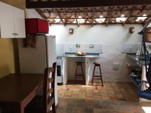A cozinha ou cozinha compacta de Condominio dos Nativos