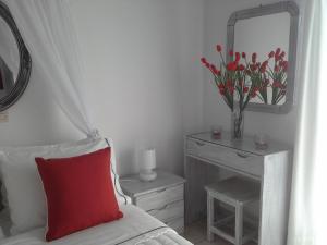 Un ou plusieurs lits dans un hébergement de l'établissement Kiklamino Studios & Apartments
