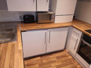 A kitchen or kitchenette at Hampden Glasgow Tenement Flat