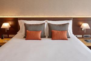 Un ou plusieurs lits dans un hébergement de l'établissement Gran Hotel Domine Bilbao