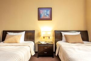 A bed or beds in a room at Festa Sofia Hotel