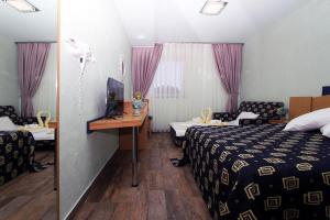 A bed or beds in a room at Iris Hotel