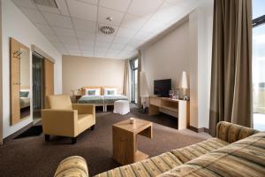 Ein Bett oder Betten in einem Zimmer der Unterkunft Hotel der Freiraum